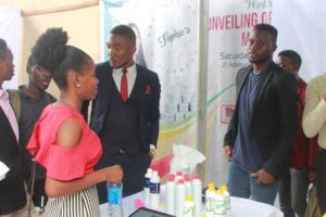 Business Development students presenting organic drink