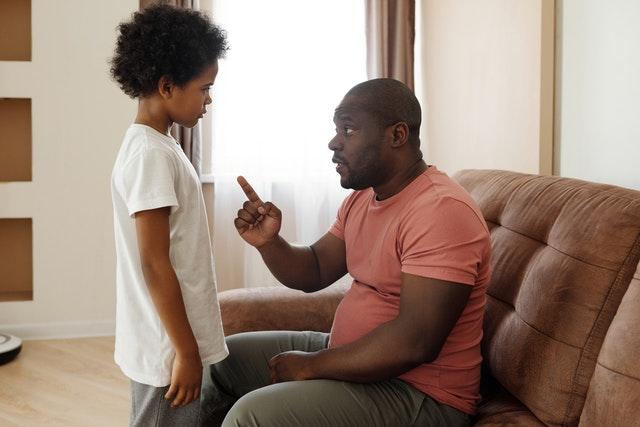Man talking to son